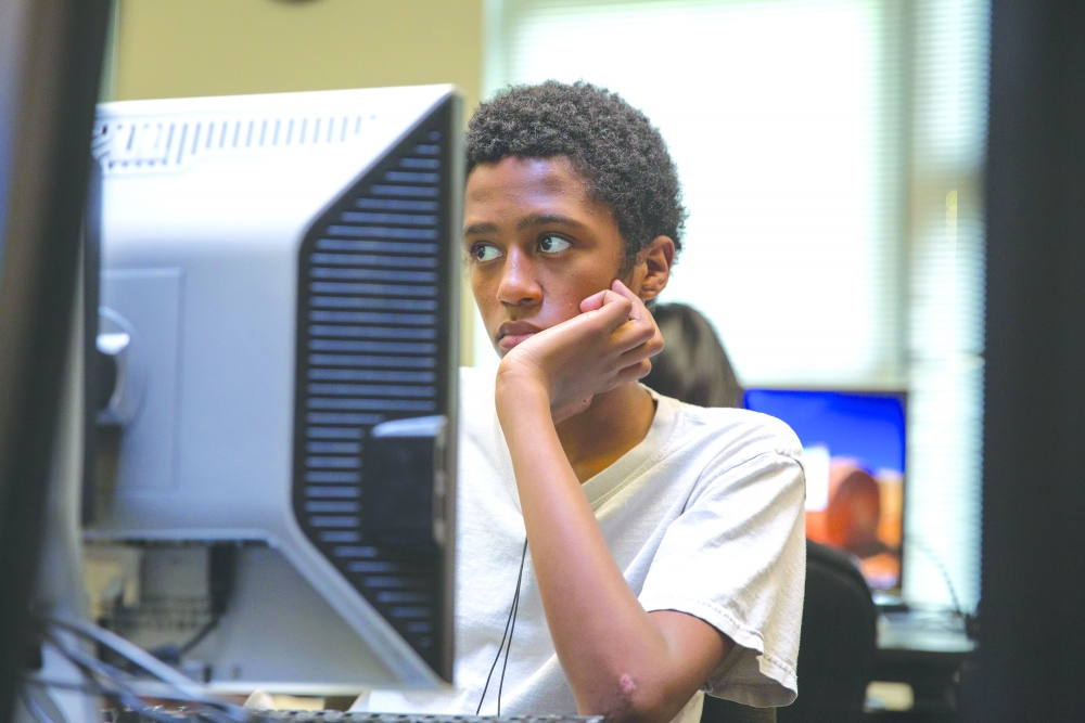 Samson Alem, a member of the Past Group, watches videos online for motivation.