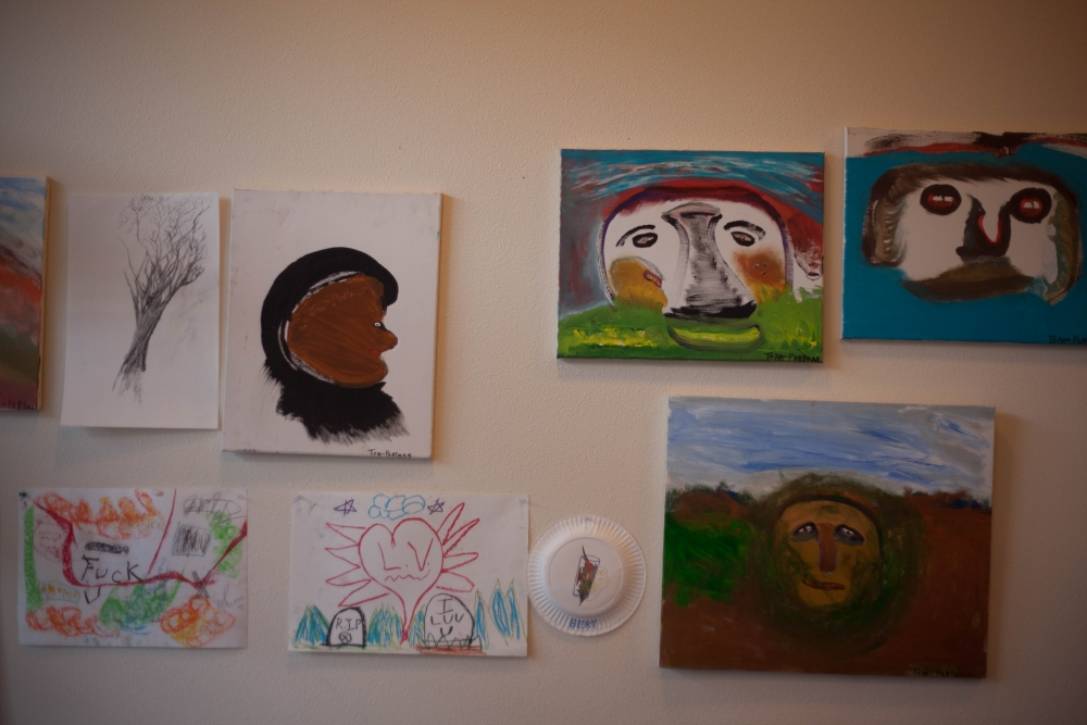 Art created by residents of 1811 Eastlake hangs on the walls of the building.