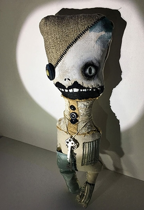Adams used old buttons, pieces of sweater and other items to create several soft sculptures in the show.