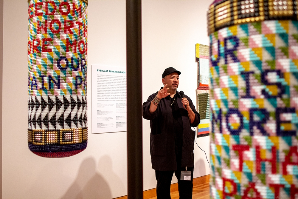 "Artist Jeffrey Gibson discusses his work at a press tour before the opening of ""Like  A Hammer."" Photo by  Natali Wiseman."