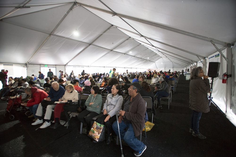 Dozens of patients wait under a tent for treatment. Photo by Matthew S. Browning