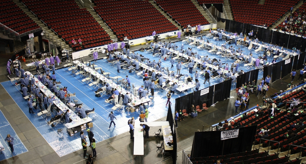 The floor at KeyArena is filled with dental exam stations. Photo by Steve Steinberg