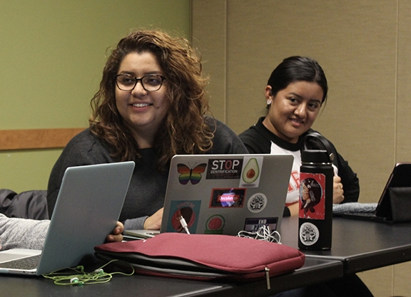 UW MEChA members Guadalupe Mendoza and Marilú Fernandez attend one of the two weekly meetings on Nov. 20. Photo by Blake Peterson