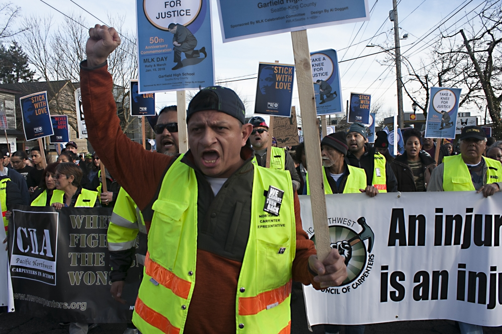 José Juarez marches with the Pacific Northwest Regional Council of Carpenters. Photo by Jon Williams