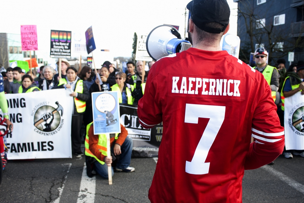 """The theme of the MLK Seattle celebration was """"Take A Knee For Justice."""" Photo by Jon Williams"""