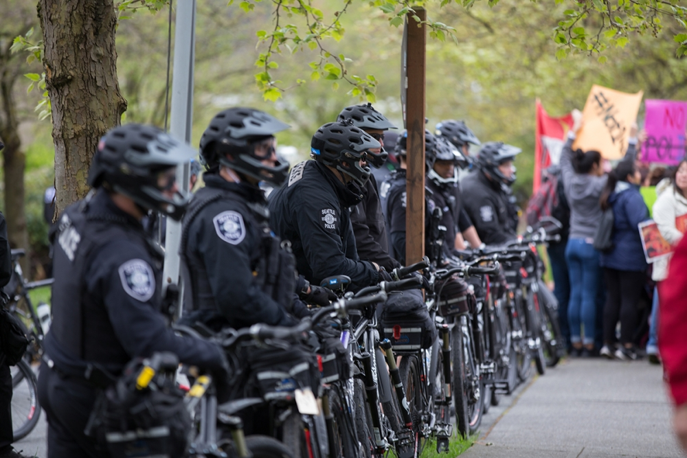 Police officers from several jurisdictions made sure marchers stayed on the approved route. Photo by Alex Garland