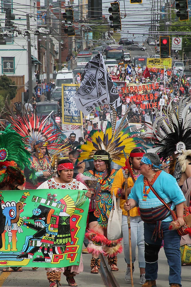 The march was led by members of of the Danza Azteca dance group. Photo by Jon Williams
