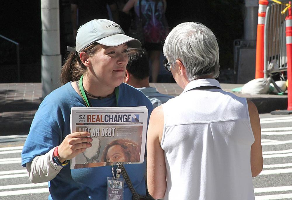Mellie Kaufman with a customer.