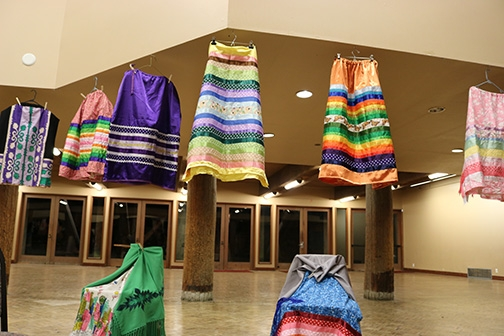 "Ribbon skirts Growing Thunder sewed while in high school are on display. One skirt was made in response to  the ""White Power"" shirts worn by some of her Polson High School classmates. Photo by Lyndsey Brolini"