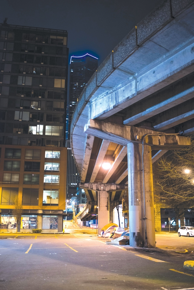 Many people in Seattle sleep without a roof over their heads every night but Seattle's homeless population settle for a viaduct, if they can find shelter from the elements at all. Photo by Andrew Waits