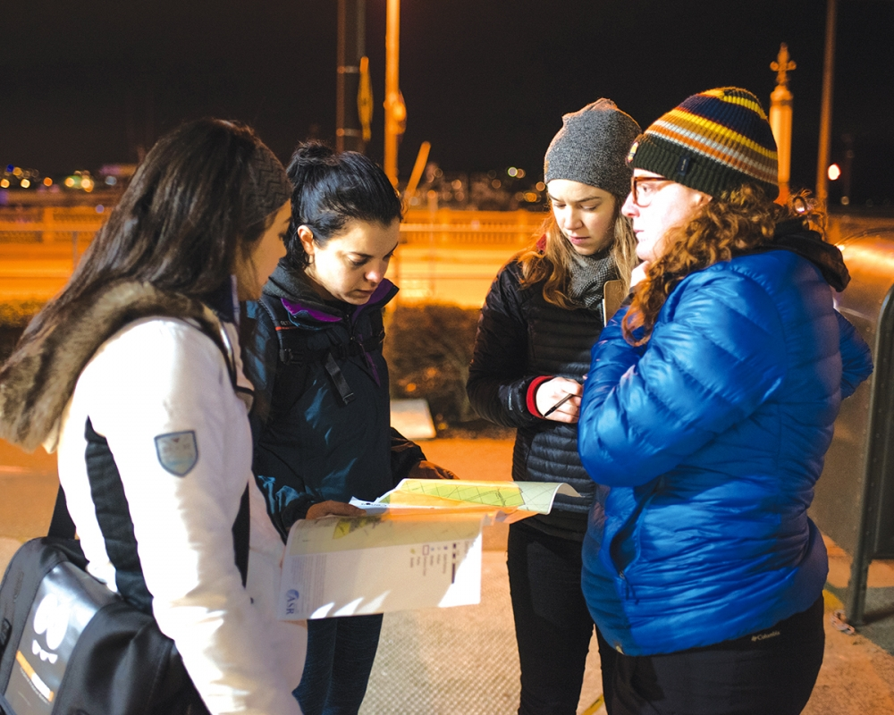 Four members of the group covering Seattle's waterfront and downtown pause for a moment to review their map and plan their next steps. Photo by Andrew Waits