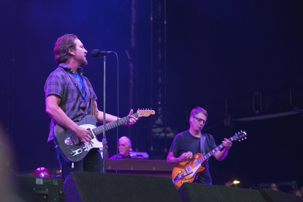 Pearl Jam's Eddie Vedder and Stone Gossard performs Aug. 8 at Safeco Field. The band raised millions of dollars for homeless organizations, including Real Change. Photo by Matthew S. Browning