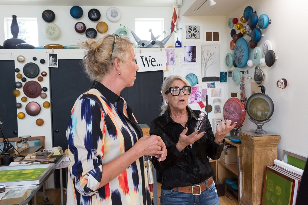 Jenny Pohlman and Sabrina Knowles talk about their work inside their studio. Photo by Lisa Hagen Glynn
