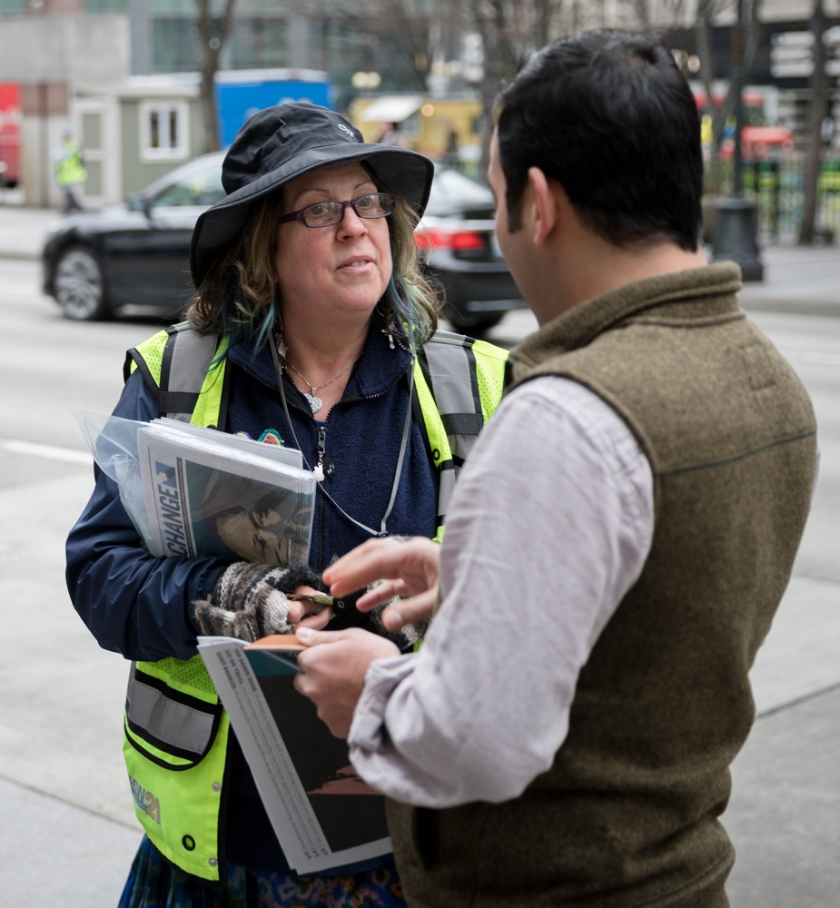 Vendor Susan Russell talks with a reader. Photo by Sam Holman