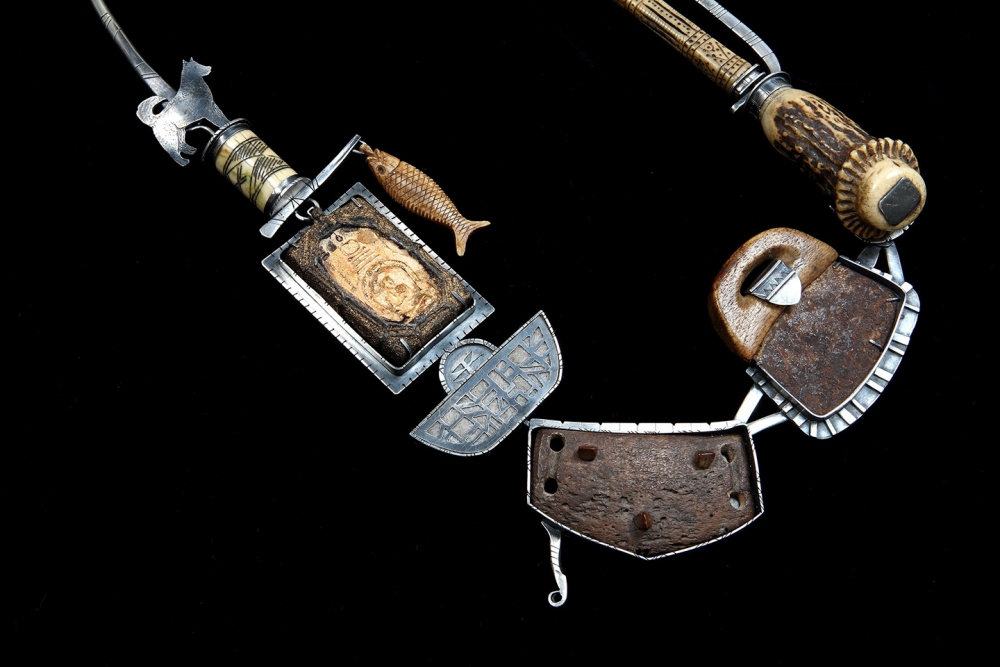 """""""Bear's Reliquary,"""" 2008, found objects, Tibetian reliquary, felted dog hair, Eskimo ulu knife, Eskimo snowshoe grip, antler, Afghanistan bone carving with forged and fabricated silver."""