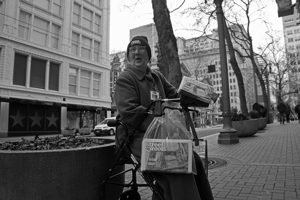 Street Roots vendor Paulette Bade sells the paper in Portland. Photo courtesy of Street Roots