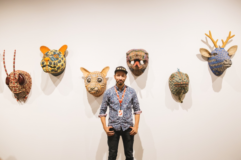 Seattle artist George Rodriguez and his sculptures. Foster/White Gallery at Seattle Art Fair 2018. Photo Credit: Sunny Martini. Courtesy of Seattle Art Fair.
