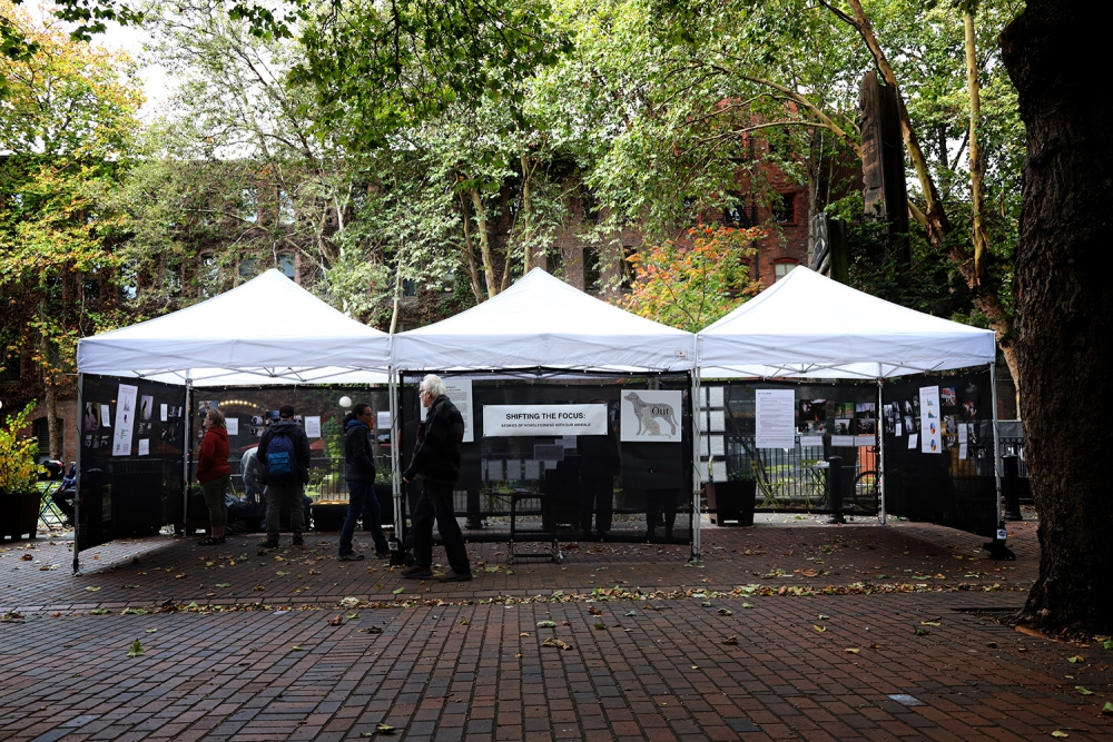 """Shifting the Focus,"" an exhibit about how pets benefit the lives of people who are experiencing homelessness, shows in Occidental Park. Photo by Jon Williams"