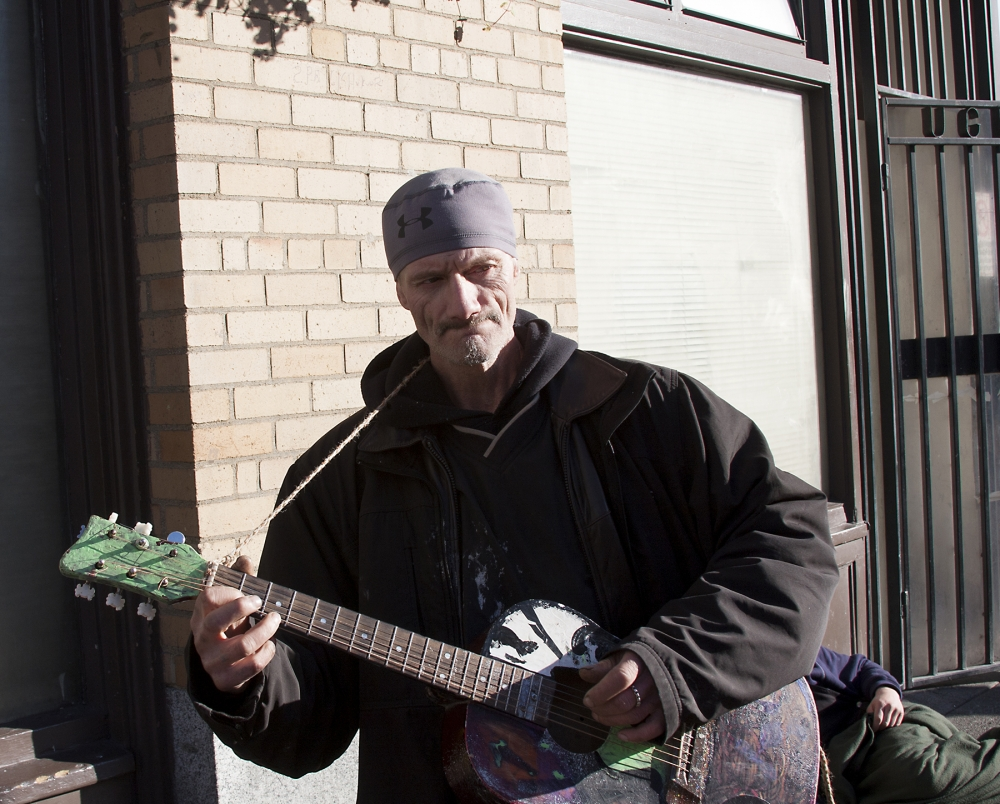 Shone Delyle talks — and sings — about homelessness in front of UGM on Third Avenue. Photo by Jon Williams