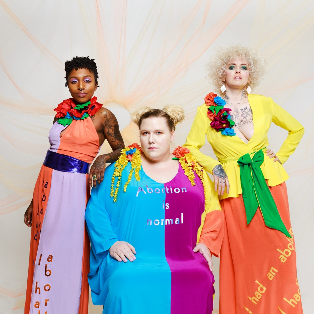 Glamorizing abortion by putting the word itself on clothing is an intentional effort of SYA. The goal is to end the stigma and open up conversations about abortion. From left, Alana Edmondson, Lindy West, Shannon Perry.