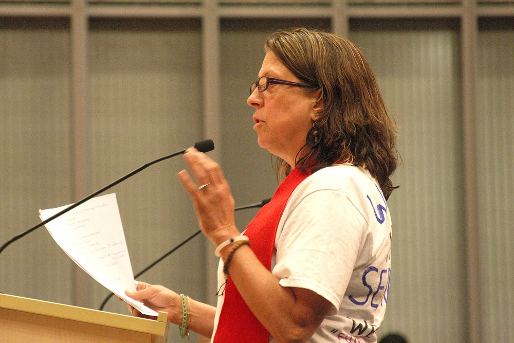 Real Change vendor Susan Russel testifies to the Seattle City Council in 2015. Photo by Jon Williams