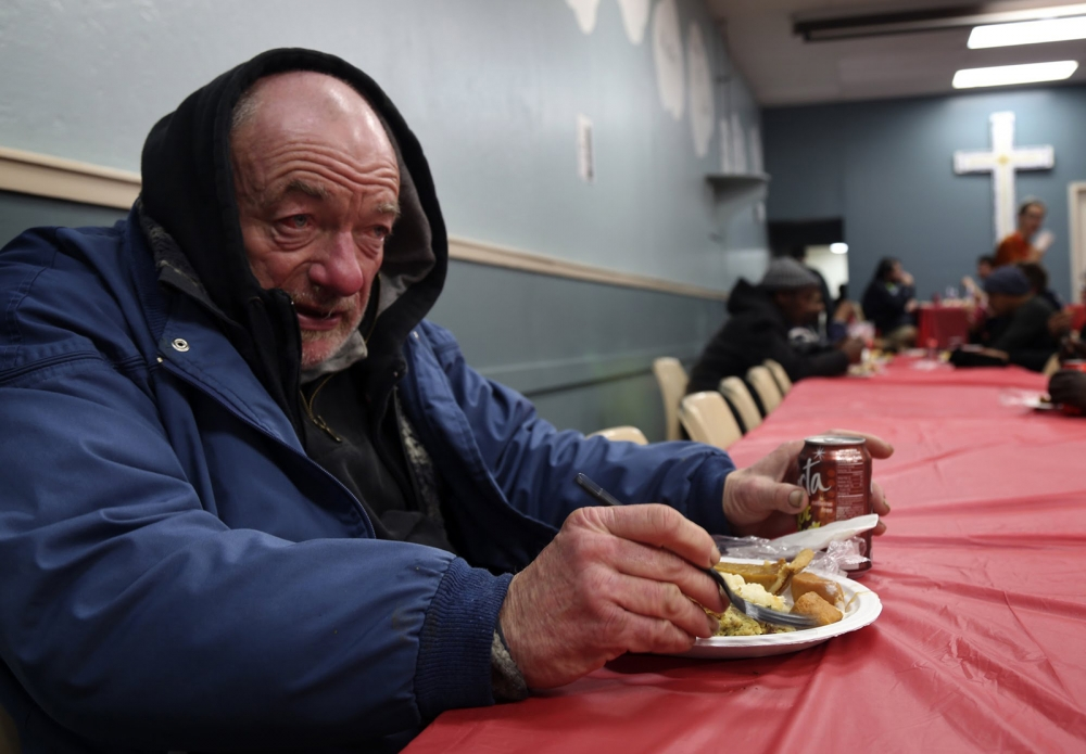 Will sits down to enjoy a Thanksgiving meal at the Bread of Life Mission in Seattle on Nov. 23.
