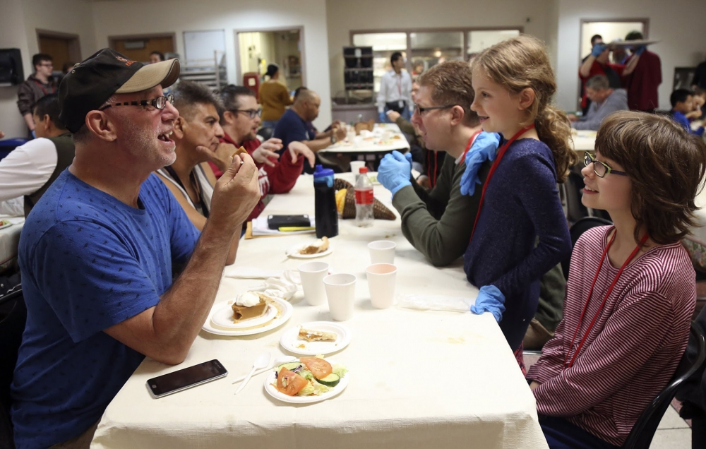 The Peterson family, right, came from Bellevue to serve meals and talk with guests at The Salvation Army in Seattle.