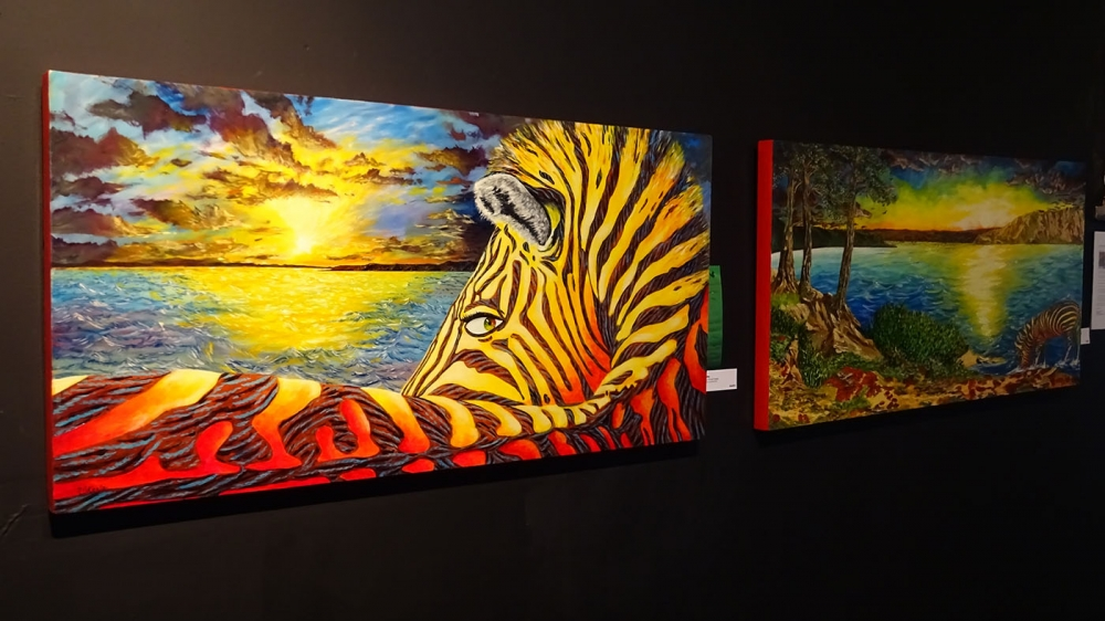 Vincent Keele uses realism and impressionism in several of his paintings on display at King Street Station. Photo by Lisa Edge