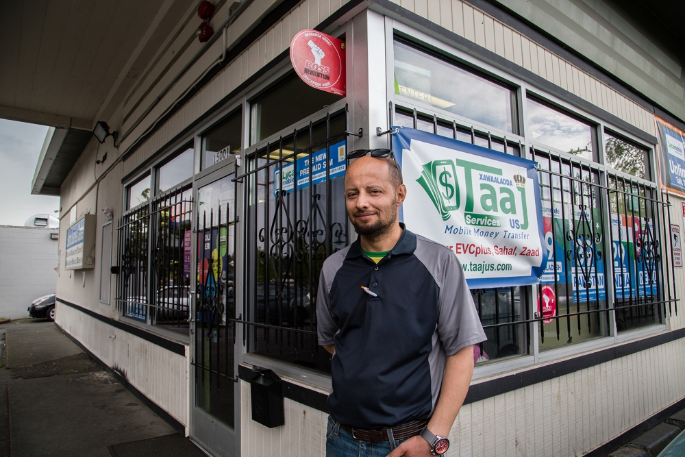 Tawfik Maudah, owner of Bayview Motor Club, stands in front of Salama Business Center, which houses his office. The business center is at risk of closing because of the city's plan. Photo by Matthew S. Browning