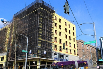 An apartment building under construction at the corner of 50th Street and University Way. Photo by Amy Wong