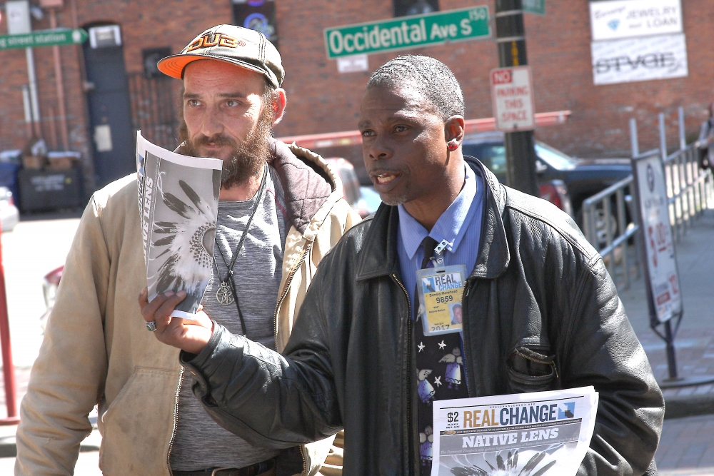 Longtime Real Change Vendor Donald Morehead, right, helps train Vendor Bill Northington. Photo by Jon Williams