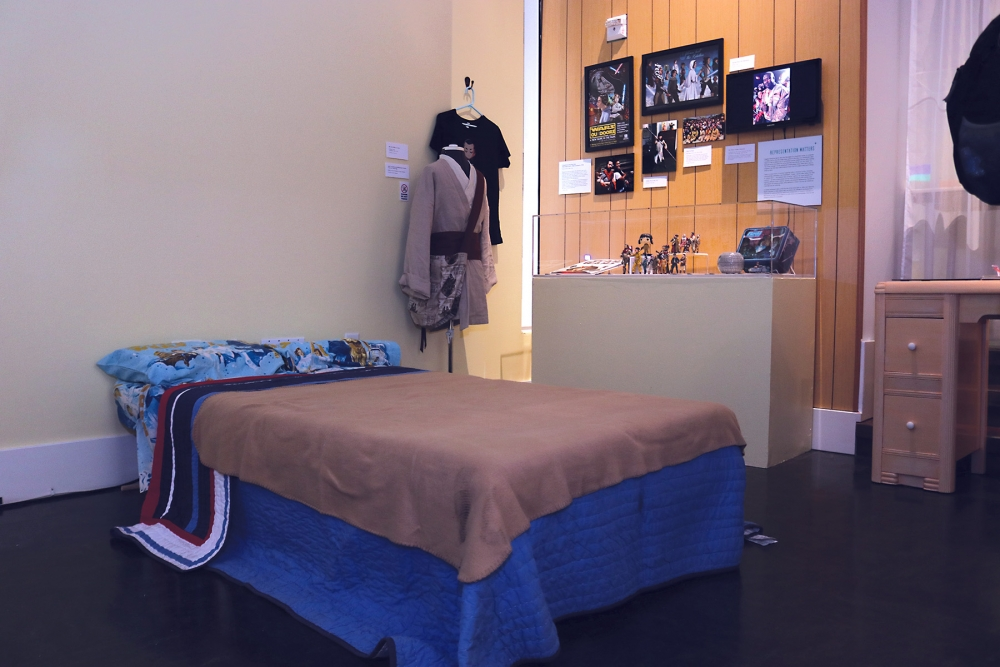 "Where it all begins: A Star Wars themed bedroom opens up the ""Worlds Beyond Here"" exhibit at Wing Luke Museum."