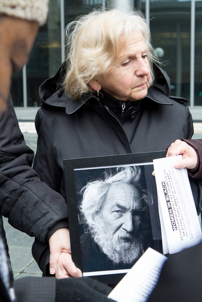 Patti Doyle holds a photo of Mark Rice who passed away of natural causes on Feb. 21. Rice was 67. Photo by Wes Sauer