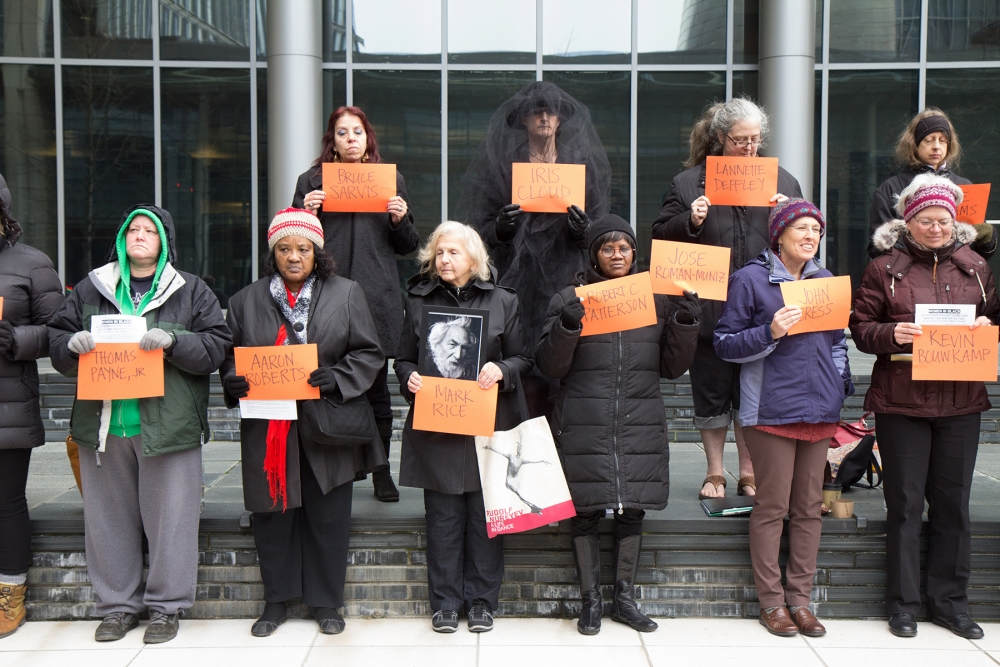 Members of Women in Black stand vigil for 22 homeless people who have died in King County during the first two months of 2017. Photo by Wes Sauer