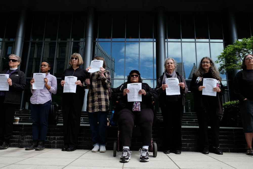 Members of Women in Black hold a vigil at the Seattle Municipal Court in honor of  the now 42 homeless people who have died outside this year. Photo by Alex Bergstrom