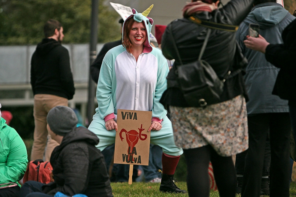 Brooke Winterling poses for a photo at the end of the march in Seattle Center. Photo by Joseph Romain