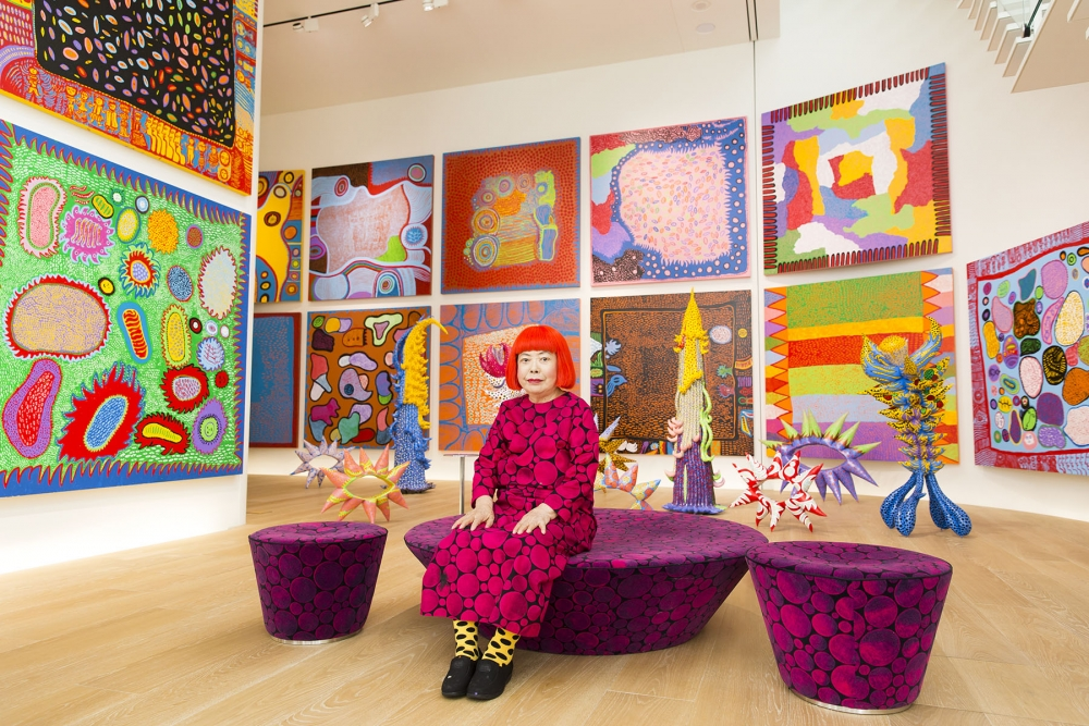 """Yayoi Kusama poses with works from """"My Eternal Soul."""" Photo provided by SAM"""