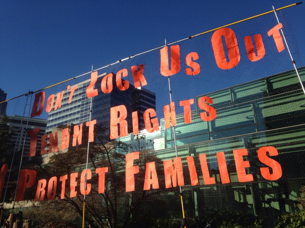 "Tenant rights are an ongoing fight; in December 2017, the Rally for Tenant Rights demanded ""don't lock us out"" at a protest outside the Washington State Convention Center. Courtesy of the Backbone Campaign, Flickr"
