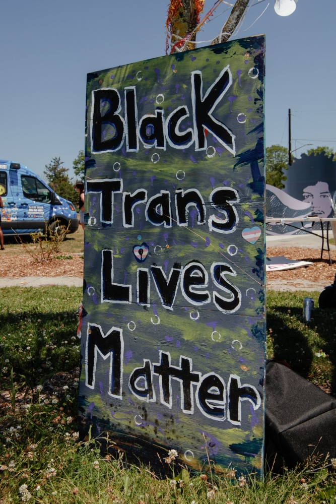 Attendees supported the antiracist event with signs and an admission fee for white attendees.
