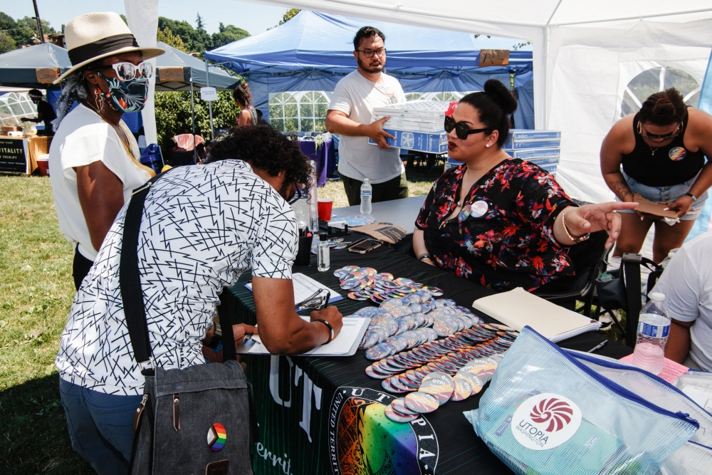 Resource tents at Taking B(l)ack Pride were filled by groups, including U.T.O.P.I.A. Washington, providing mutual aid, June 26.