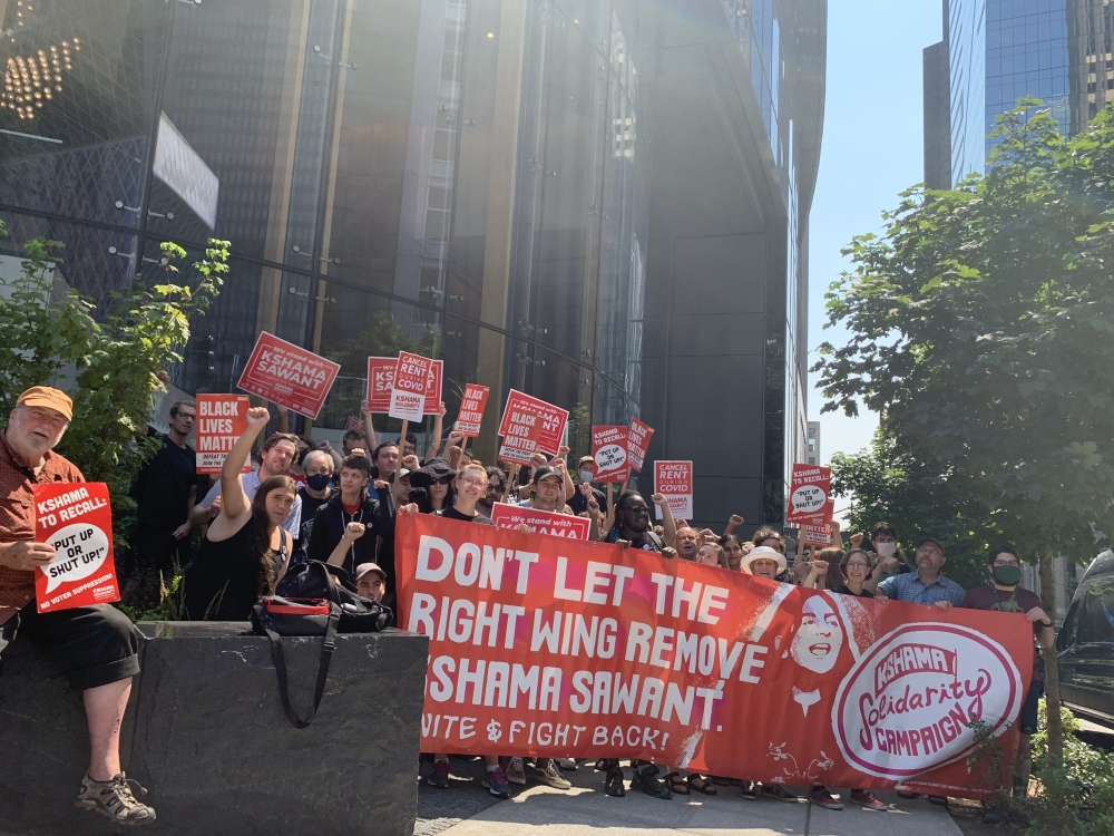 Supporters of City Councilmember Kshama Sawant made their voices heard Aug. 2 outside the offices of the recall's lawyer.