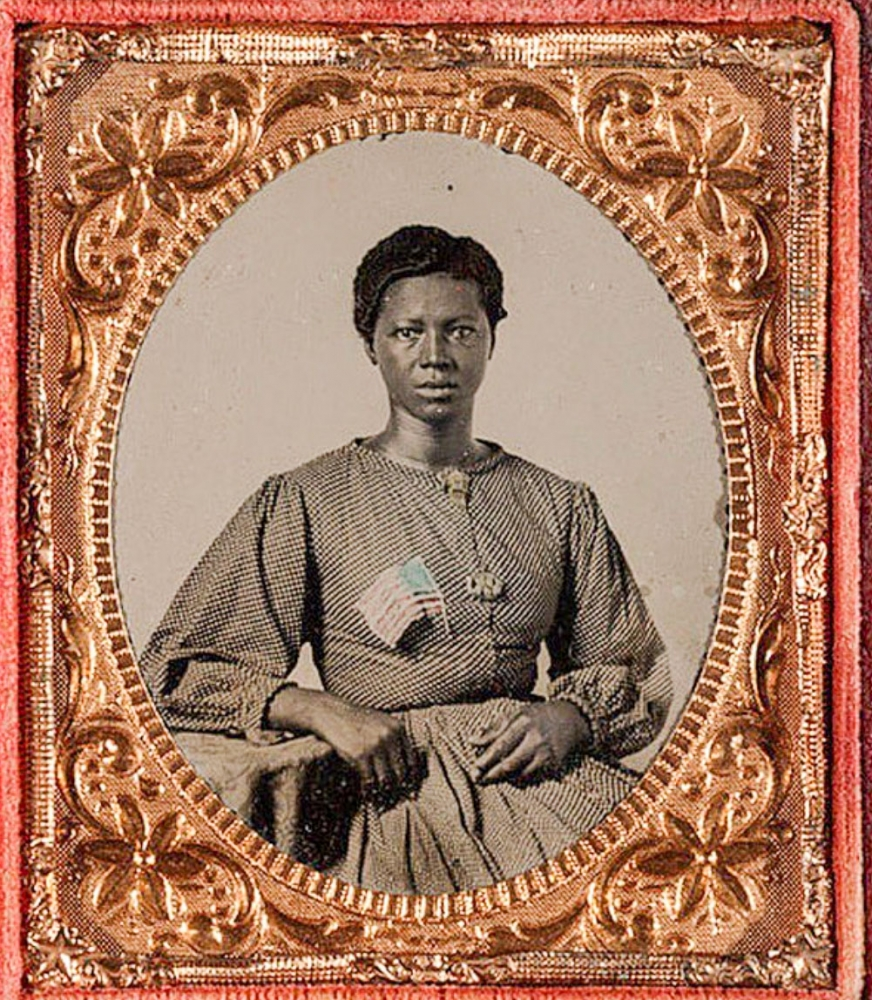 """This 1865 picture of an unidentified washerwoman inspired Helmstetter's 2021 adaptation, """"Portrait of a Union Army Laundress/Woman in Pink."""""""