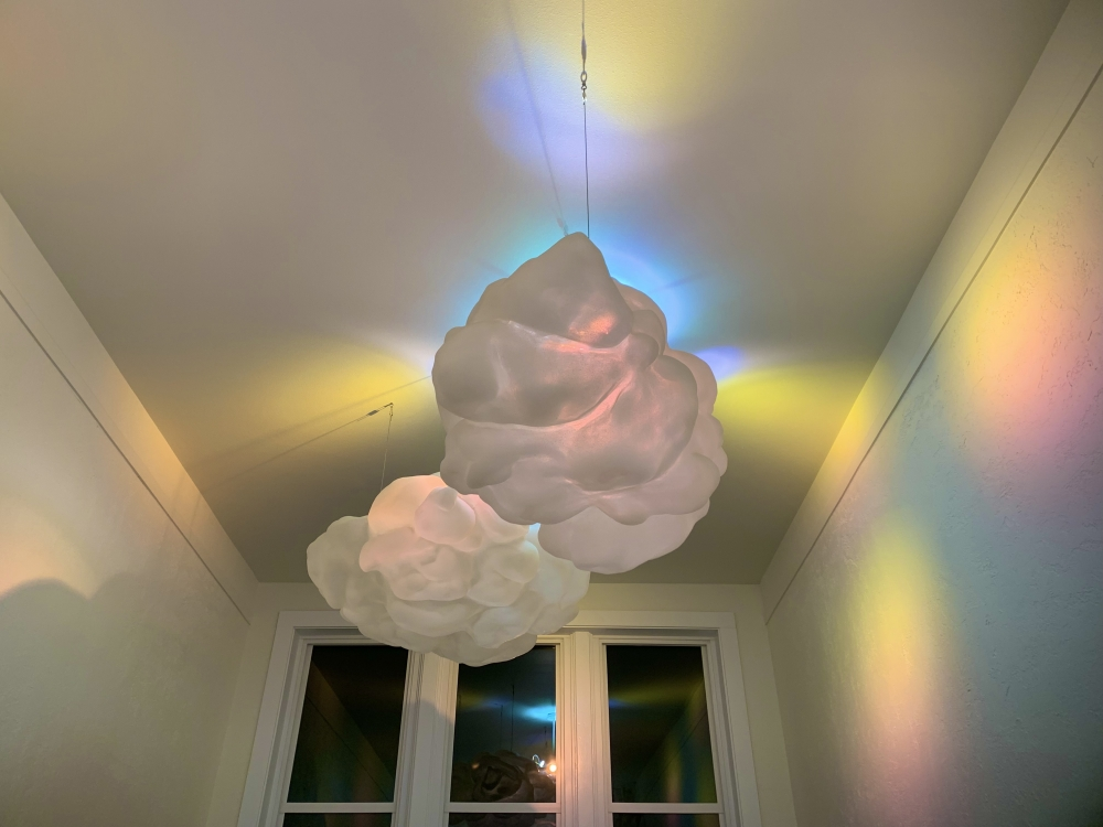 """""""Gathering Radiance"""" incorporated shifting colored lights and handcrafted clouds in a permenant installation at Western Orgeon University."""