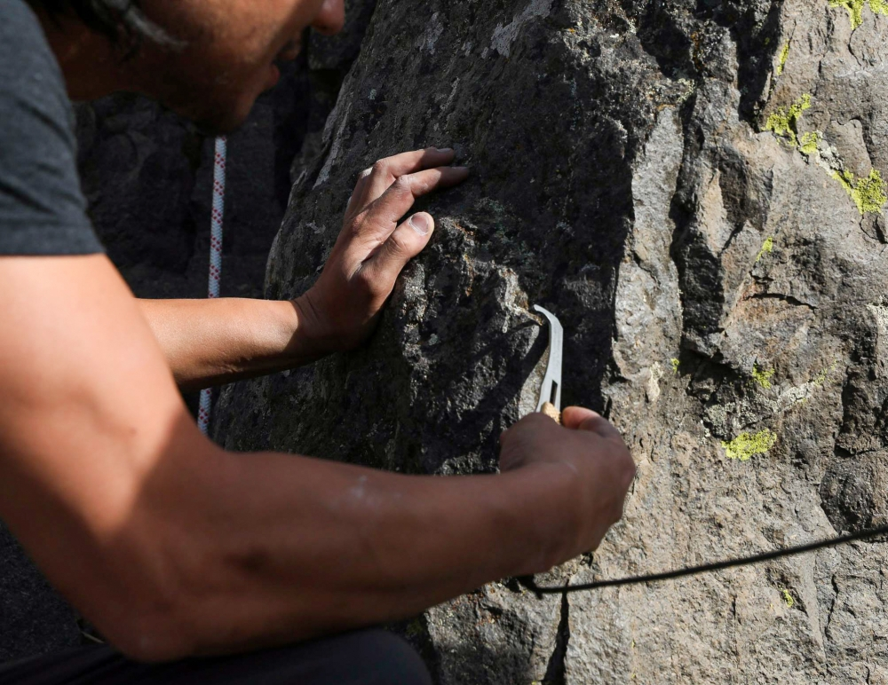 In summer 2020, climber Lyquoc Vo demonstrates how to use a nut key. Nut keys are for traditional (trad) climbing and help climbers get pieces of equipment out of a rock wall. Trad climbers do not use bolts to help them up a rock wall. Instead, they place
